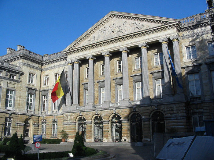 The flag of Belgium flies outside the Belgian Federal Parliament building in Brussels