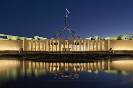 Australian flag flying atop Parliament House in Canberra
