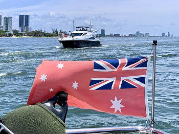 The Australian Red Ensign attached to a vessel on the water in Queensland, Australia