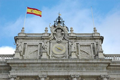 The flag of Spain flies outside the Royal Palace of Madrid