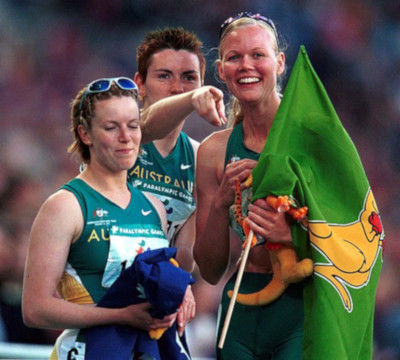 Australian athletes hold the Boxing Kangaroo flag at the 2000 Summer Olympic Games in Sydney, Australia
