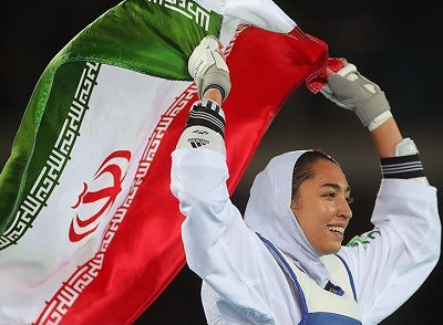 Iranian athlete Kimia Alizade performs a lap of honour with the flag of Iran during the 2016 Summer Olympic games in Brazil